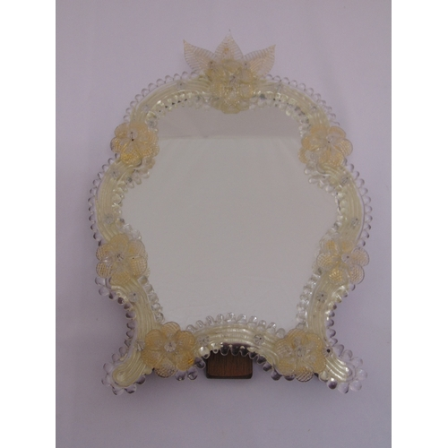 26 - A Venetian shaped glass decorative table mirror with hinged back strut, 40cm (h)...
