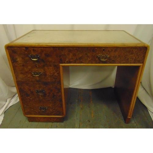 1 - An Art Deco walnut veneered rectangular desk with one long drawer and three short drawers, 77 x 99 x...