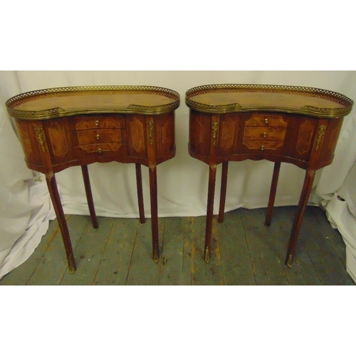 12 - A pair of mahogany kidney shaped side tables with scroll pierced gallery tops each with three drawer...