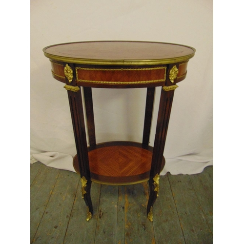 16 - A French oval mahogany and kingswood parquetry and gilt metal occasional table on four cabriole legs...