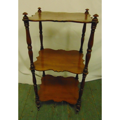 20 - A mahogany shaped rectangular three tier whatnot with four turned cylindrical supports, 82 x 38.5 x ...