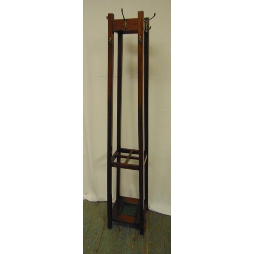 25 - An oak hat, coat and umbrella stand, rectangular with applied coat hooks, 174cm (h)...