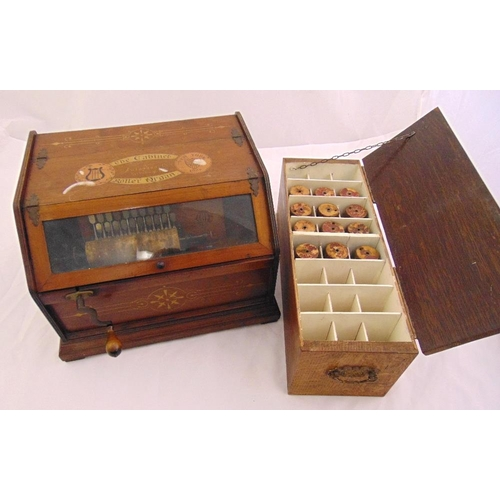 251 - A Cabinet Roller Organ by the Autophone Co. Ithaca New York, glazed rectangular with hinged an inlay...