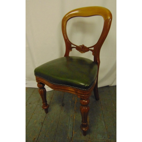 30 - A Victorian beech wood spoon back chair with leather upholstery on carved baluster legs...