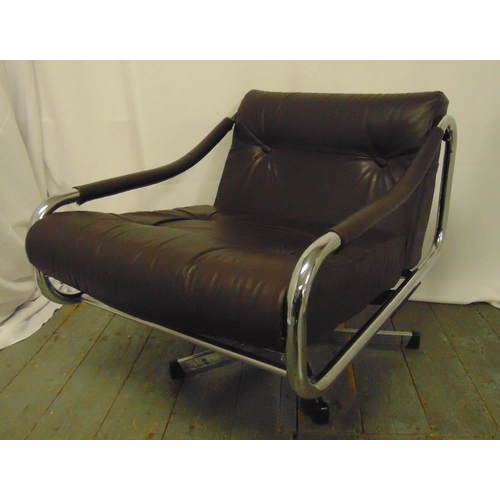 34 - A late 20th century chrome and leather revolving armchair...