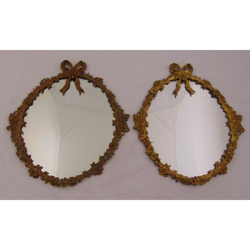 36 - A pair of 19th century wall mirrors with ormolu frames of leaves and flowers surmounted by ribbons, ...
