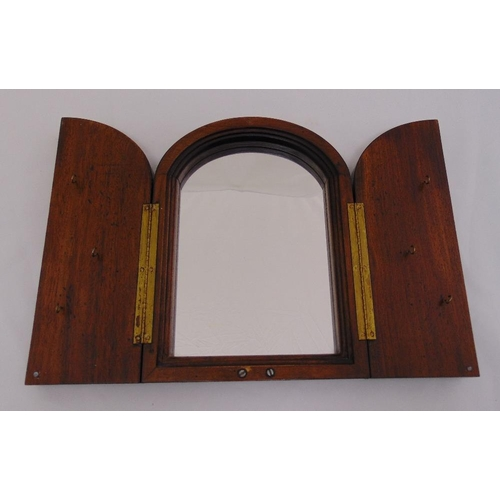 38 - A mahogany wall mirror, arched top the hinged doors set with key hooks, 30 x 22cm...