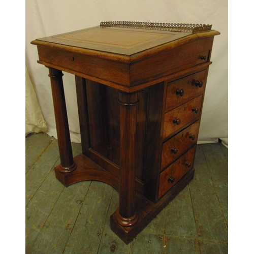 4 - A Victorian mahogany Davenport of customary form with tooled leather hinged top, five drawers on sha...