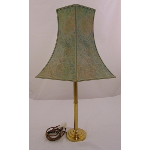 40 - A gilt metal table lamp of tubular form on stepped circular base with shade, 74cm (h)...