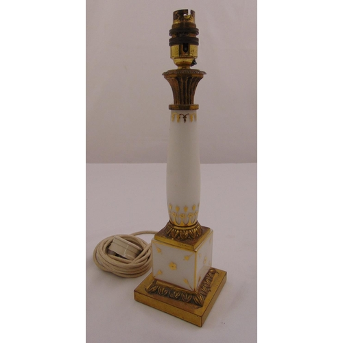 42 - A glass lamp stand of columnular form with gilded decoration on raised square base, 35.5cm (h)...