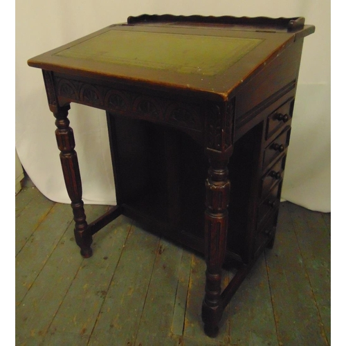 5 - An oak Davenport of customary form with tooled leather hinged top and five drawers, 81 x 62.5 x 51cm...