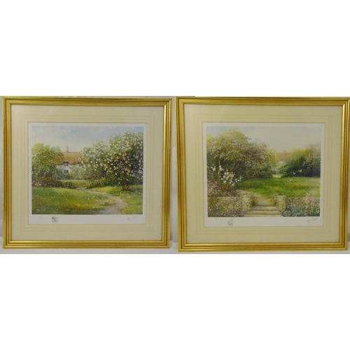 55 - Hillary Soffield a pair of framed and glazed limited edition prints of English country gardens, sign...
