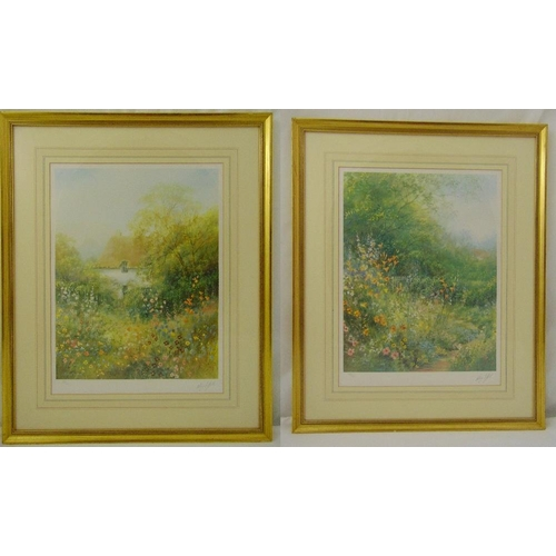 56 - Hillary Soffield a pair of framed and glazed limited edition prints of cottage gardens, signed botto...