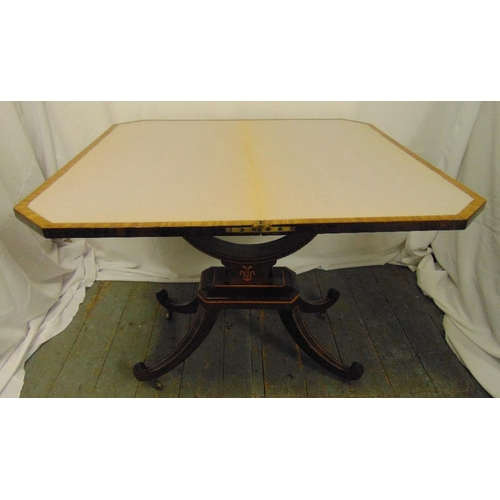 6 - An Edwardian rectangular games table with satinwood inlaid decoration, hinged top on four out stretc...
