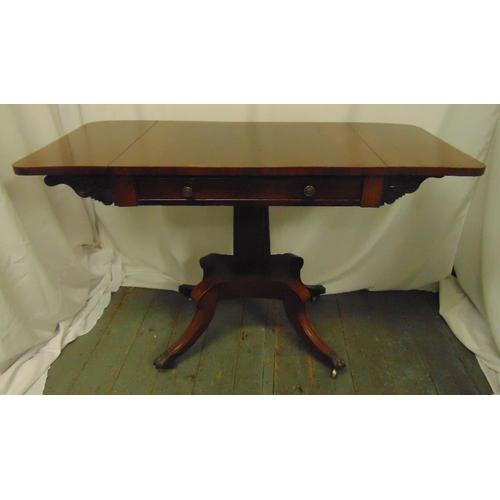 7 - A Regency drop leaf mahogany Pembroke table on quadriform base with brass paw feet, 75 x 120.5 open ...