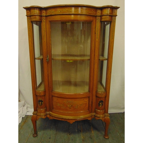 8 - An Edwardian mahogany and satinwood glazed display case shaped rectangular with bow front, decorated...