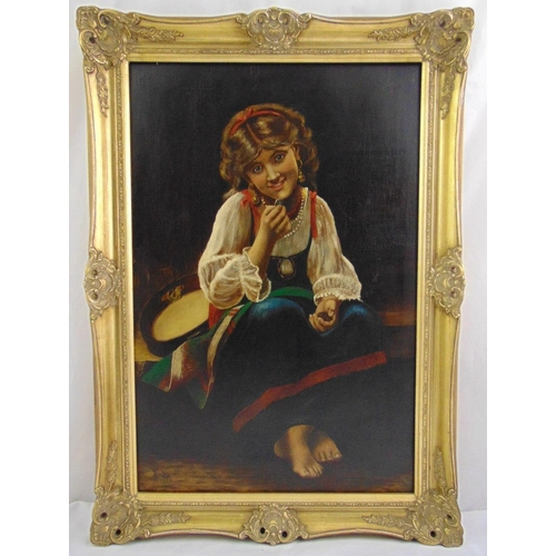 81 - A framed oil on canvas of a seated girl with a tambourine, monogrammed FL and dated 1880 bottom left...