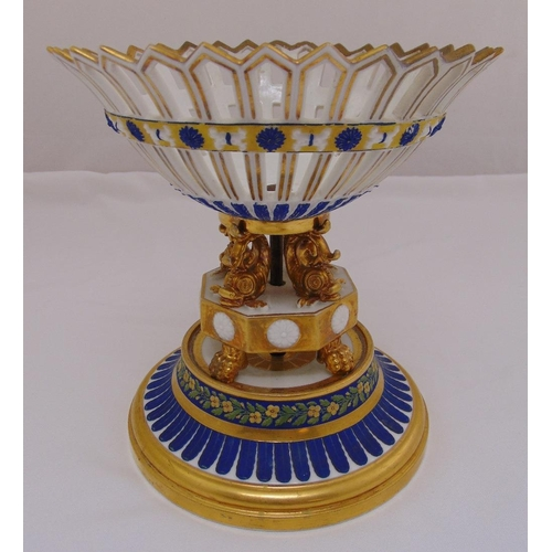 124 - Dante Aime A Paris porcelain table centrepiece, the pierced bowl supported by dolphins on raised cir...