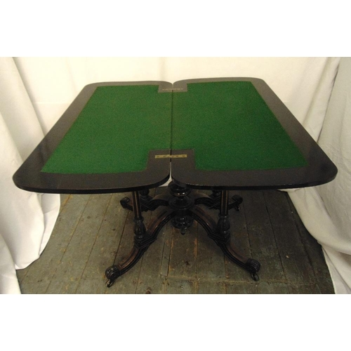 10 - A Victorian ebonised games table on four outswept legs, 73 x 92 x 45cm