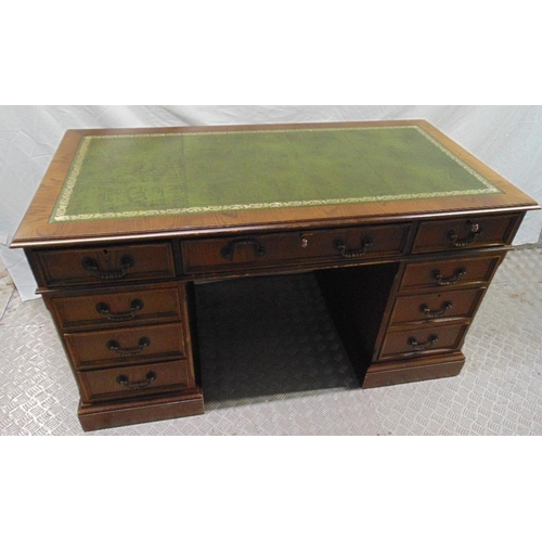 14 - A reproduction mahogany pedestal desk with tooled leather top, brass handles, 76.5 x 137.5 x 69cm