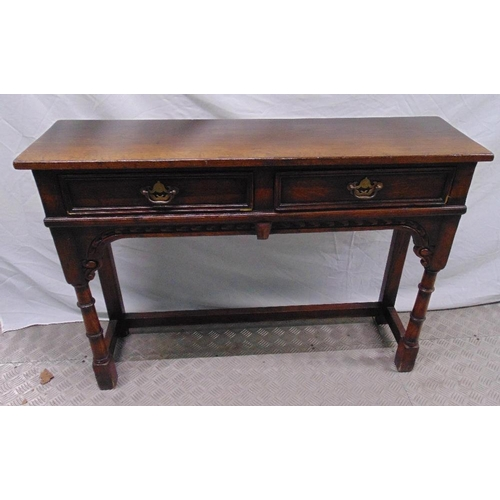18 - A 19th century oak consol table with two drawers with hinged swing handles, 76 x 106.5 x 30cm