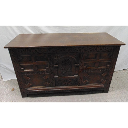 20 - A 19th century oak blanket box the front and sides carved with flowers and scrolls, hinged cover, on...