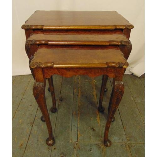 24 - A mahogany and walnut nest of three tables on cabriole legs, 53.5 x 55.5 x 37cm