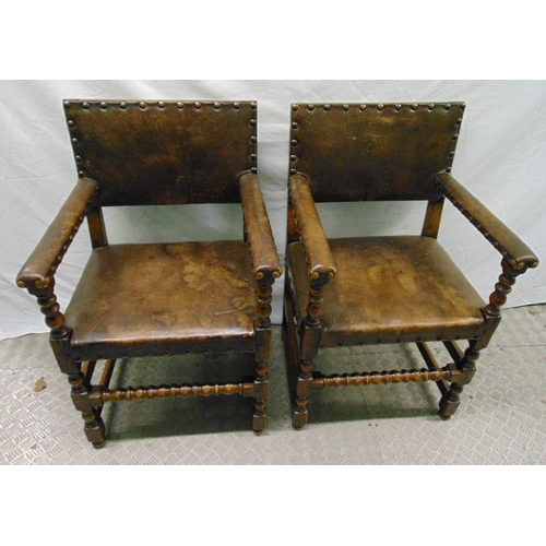 30 - A pair of 19th century oak and leather armchairs with turned legs and stretchers