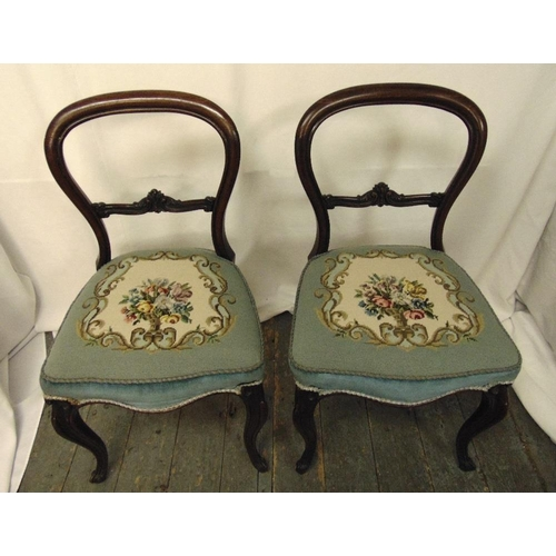 33 - A pair of Victorian mahogany balloon back occasional chairs with tapestry seats on cabriole legs, he...