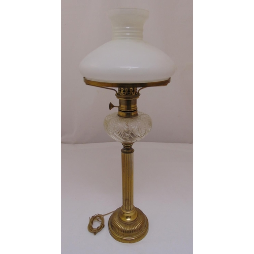 39 - A Victorian brass oil lamp with frosted shade converted to an electric table lamp, 68.5cm (h)