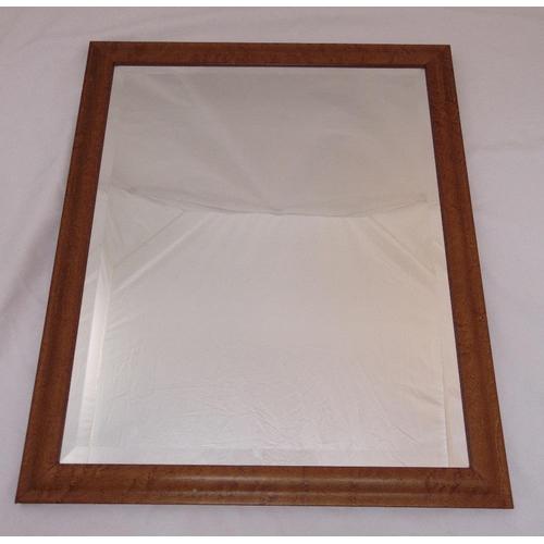 46 - A rectangular bevelled wall mirror in a walnut veneered frame, 68 x 58 cm