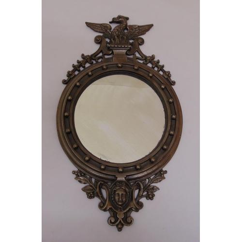 47 - A 19th century style cast metal wall mirror, 50 x 28.5cm