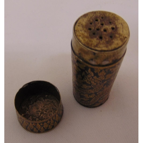 391 - A continental Niello work pepperette of cylindrical form with pull off cover, 5.3cm (h)