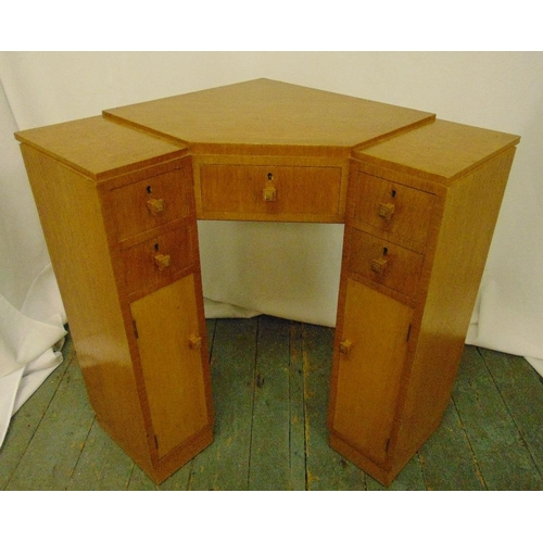 5 - An Art Deco blonde oak corner desk with seven drawers and turned handles, 74 x 65.5 x 63cm