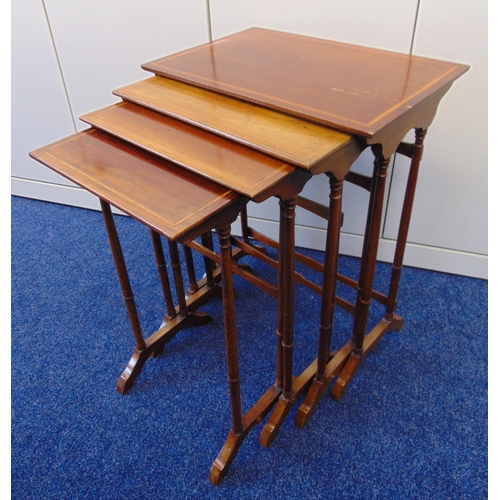 11 - A nest of four rectangular tables inset with satinwood banding on scroll supports, 68.5 x 35.5 x 53....