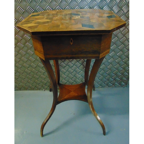 13 - A mahogany inlaid needlework table of elongated octagonal form the hinged cover revealing a lined in...
