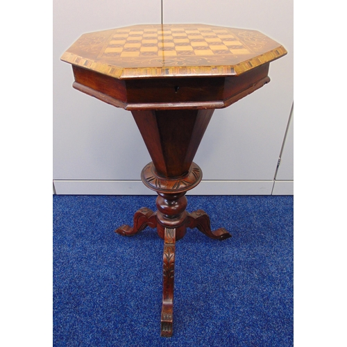 14 - A Victorian octagonal mahogany and satinwood sewing table, the hinged cover revealing a fitted inter...