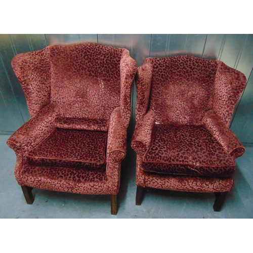 17 - Two upholstered Mummy and Daddy wing back armchairs on four tapering rectangular legs