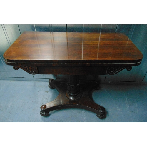 2 - A Victorian rectangular mahogany games table, the hinged top on column support and shaped square bas...