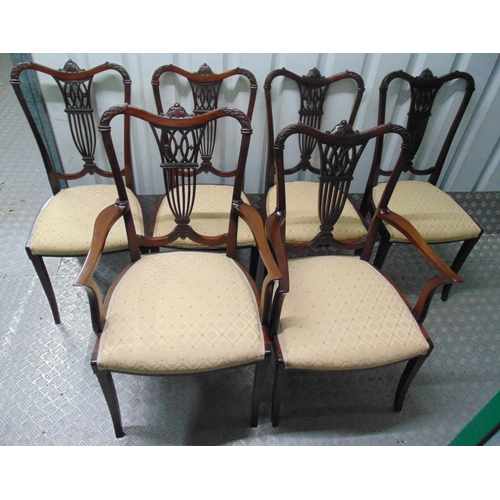 21 - A set of six Edwardian dining chairs, two carvers, carved and pierced backs on tapering cylindrical ...