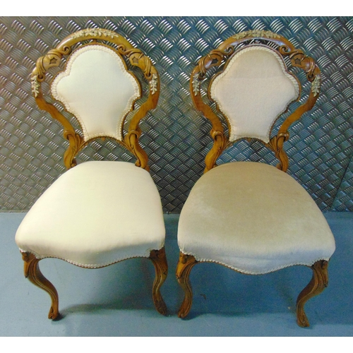 23 - A pair of continental upholstered occasional chairs on scroll legs