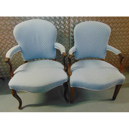 25 - Two upholstered mahogany armchairs