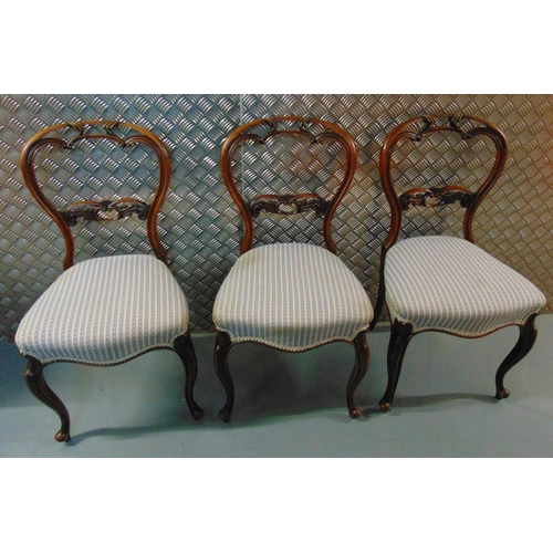 26 - Three Queen Anne style mahogany dining chairs, scroll and pierced carved backs on cabriole legs