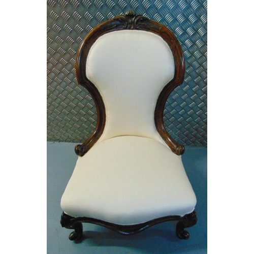 27 - A Victorian ladies mahogany nursery chair with upholstered seat and back on four scroll legs