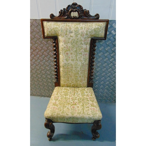 28 - A Victorian mahogany upholstered prayer chair with barley twist column sides on four scroll legs