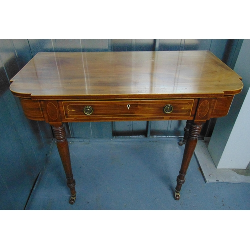 3 - A late 19th century shaped rectangular mahogany desk, the single drawer with two brass swing handles...