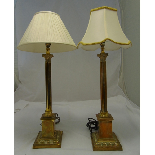 36 - A pair of brass Corinthian column table lamps on stepped square bases, to include shades, 82cm (h)