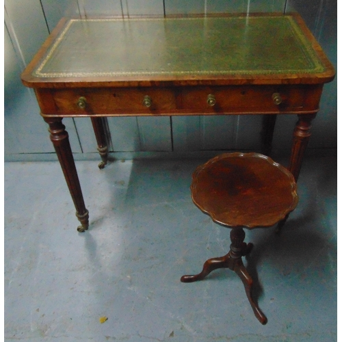 4 - An Edwardian rectangular hall table with tooled leather top, two drawers on four fluted tapering cyl...