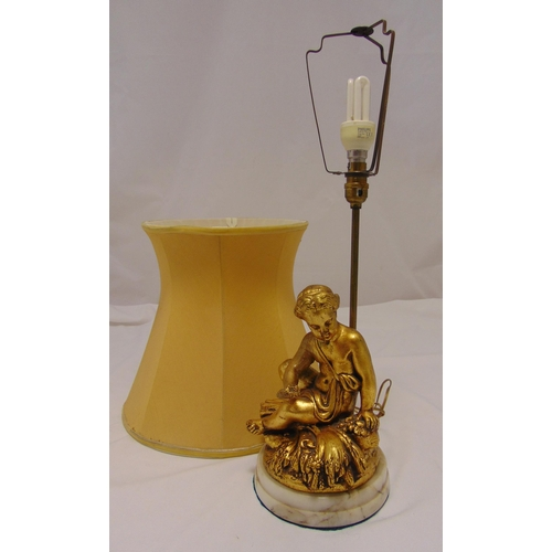 40 - A gilded composition table lamp in the form of a classical female figurine on raised circular marble...