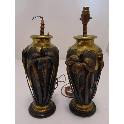 41 - A pair of Art Nouveau style table lamps, copper and brass ovoid form with applied flowers and leaves...